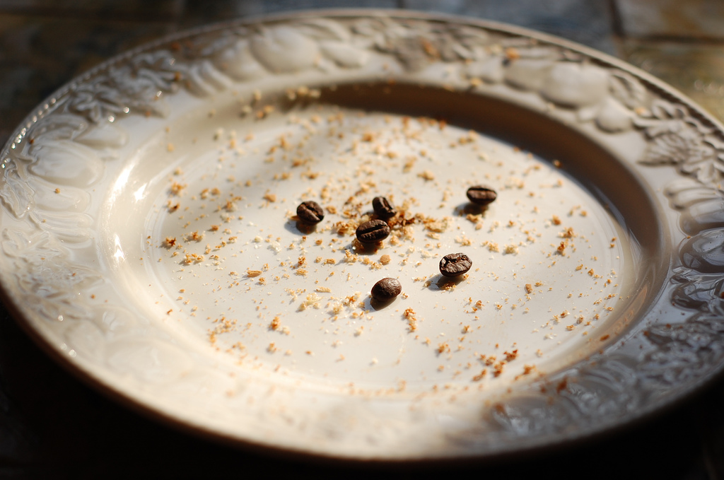 coffee beans and crumbs on a plate